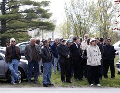People wait to board buses to go to a wake for musician Levon Helm at his home in Woodstock, N.Y., on Thursday, April 26, 2012. Helm, a former member of The Band, four-time Grammy Award winner and member of the Rock and Roll Hall of Fame died last week at age 71 after a battle with cancer. (AP Photo/Mike Groll)