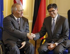German Finance Minister Wolfgang Schaeuble, left, and his U.S. counterpart Jacob J. Lew, right shake hands prior to a press conference as part of a meeting at the finance ministry in Berlin, Germany, Tuesday, April 9, 2013. Treasury Secretary Jacob J. Lew met Tuesday with Finance Minister Wolfgang Schaeuble as part of the US official's tour of Europe. (AP Photo/Michael Sohn)
