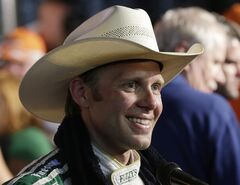 Ed Carpenter wears a cowboy hat in Victory Lane after winning the IndyCar auto race at Texas Motor Speedway in Fort Worth, Texas, Saturday, June 7, 2014. (AP Photo/Tim Sharp)
