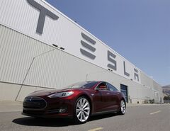 This June 22, 2012 photo shows a 2013 Tesla Model S outside the Tesla factory in Fremont, Calif. THE CANADIAN PRESS/AP, Paul Sakuma