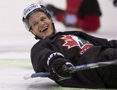 Team Canada captain Kevin Bieksa laughs on Thursday, May 8, 2014 in Minsk. THE CANADIAN PRESS/Jacques Boissinot