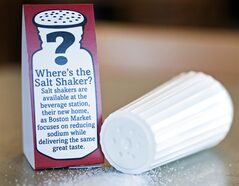A salt shaker sits next to an advisory at a Boston Market restaurant in Alexandria, Va., Tuesday, May 14, 2014. A pair of international studies are questioning the validity of the notion that the less salt a person consumes, the better. THE CANADIAN PRESS/AP, Cliff Owen