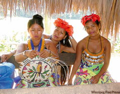 The Embera women wear brightly colour sarongs, jewelry and hibiscus flowers in their hair. Some of their income comes from making hand-made crafts like this straw bowl.
