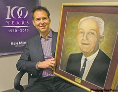 Ben Moss president and CEO Brent Trepel holds a picture of his grandfather, Ben Moss, who founded the company 100 years ago.