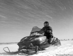 In this Feb. 10, 2011 photo, snow flies over U.S. Border Patrol agent Glenn Pickering as he rides a snowmobile along the St. Lawrence River in Massena, N.Y. This is the United States� forgotten border, where federal agents and police play cat-and-mouse with smugglers and illegal immigrants along 4,000 miles of a mostly unmarked and unfortified frontier with Canada.(AP Photo/Mike Groll)