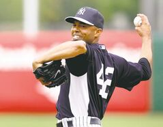 The best ever? New York Yankees relief pitcher Mariano Rivera faces down an Atlanta Braves hitter in Grapefuit League action on Thursday.