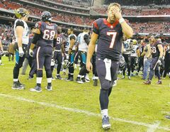 Texans quarterback Case Keenum, looking despondent, leaves the field after losing 13-6 to the Jags on Nov. 24.