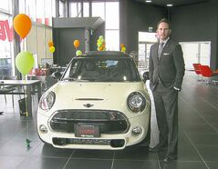 BIrchwood Mini sales rep Steven Weber with the new 2014 Mini Cooper.