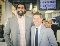 Obby Khan (left) likes Brian Bowman's idea of increasing the small-business tax credit.