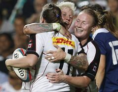 Mandy Marchak (right) celebrates with teammates after defeating France during the final match of Women's Invitational Cup at the Hong Kong Sevens rugby tournament in Hong Kong on March 28, 2014. THE CANADIAN PRESS/AP, Kin Cheung