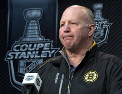Boston Bruins head coach Claude Julien speaks to the media during a news conference in Brossard, Que., on May 7, 2014. Bruins coach Claude Julien gave the on-ice officials a thumbs-up Saturday.