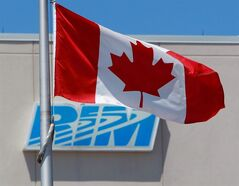 The Canadian flag flies in front of the Research In Motion (RIM) company logo on one of their buildings in Waterloo, Ont., on June 29, 2012. A northern California jury has ordered Research In Motion to pay $147.2 million in a patent lawsuit, the latest setback to hit the BlackBerry maker. THE CANADIAN PRESS/Dave Chidley