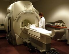 A technician operates an MRI machine at a private clinic in Calgary Wednesday, Jan. 12, 2005. A new study suggests that fewer than half of MRIs ordered to look for the cause of lower back pain are an appropriate use of the imaging machines. THE CANADIAN PRESS/Jeff McIntosh
