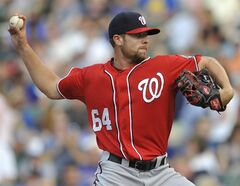 Washington Nationals starter Blake Treinen delivers a pitch during the first inning of a baseball game against the Chicago Cubs in Chicago, Saturday, June 28, 2014. (AP Photo/Paul Beaty)
