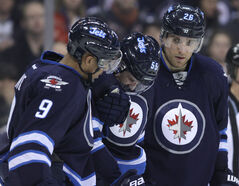 Winnipeg Jets forward Mark Scheifele (middle) has a sprained medial collateral ligament in his right knee. Fortunately, it will not require surgery.