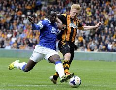 Everton player Romelu Lukaku, left, sees his shot blocked by Hull City's Paul McShane during their English Premier League soccer match at KC Stadium, Hull, England, Sunday May 11, 2014. (AP Photo/Anna Gowthorpe, PA) UNITED KINGDOM OUT - NO SALES - NO ARCHIVES