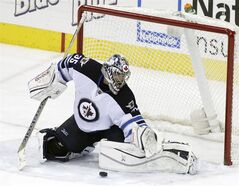 FILE - In this Dec. 16, 2013 file photo, Winnipeg Jets' Al Montoya makes a save against the Columbus Blue Jackets during the third period of an NHL hockey game in Columbus, Ohio. The Florida Panthers agreed to terms with centers Dave Bolland and Jussi Jokinen, plus goaltender Al Montoya shortly after hockey's free agent period started Tuesday, July 1, 2014. (AP Photo/Jay LaPrete, File)