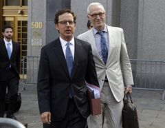 Carmine Boccuzzi, center, a lawyer representing Argentina, leaves Federal court after a hearing, in New York, Thursday, Aug. 21, 2014. Argentina will make its next round of scheduled debt payments, the economy minister said as he defends a new plan to pay creditors locally and avoid the jurisdiction of a U.S. court that forced the country into default last month. (AP Photo/Richard Drew)
