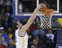 Golden State Warriors' Andre Bogut dunks against the Los Angeles Clippers during the first half of an NBA basketball game Thursday, Jan. 30, 2014, in Oakland, Calif. (AP Photo)