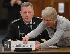 Maj.-Gen. Jonathan Vance appears as a witness at a House of Commons standing committee on Foreign Affairs and International Development on Parliament Hill in Ottawa on Thursday, Jan. 31, 2013. THE CANADIAN PRESS/Sean Kilpatrick