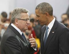 U.S. President Barack Obama and his Polish counterpart Bronislaw Komorowski, left, speak during the main celebrations marking the 25th anniversary of first partly free elections that led to the fall of communism, in Warsaw, Poland, Wednesday. Obama came to Poland to meet regional leaders and attend ceremonies marking 25 years of Poland's democracy.