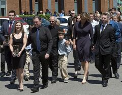 Family members carry the urns of France St-Louis, mother of New York Rangers hockey player Martin St-Louis, right, following funeral service's for Sunday, May 18, 2014 in Laval, Que..THE CANADIAN PRESS/Ryan Remiorz