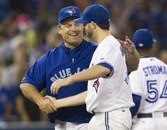 Toronto Blue Jays manager John Gibbons shakes hands with Blue Jays starting pitcher Drew Hutchison at the end of their AL baseball game against the Baltimore Orioles in Toronto Wednesday August 6, 2014. The Jays defeated the Orioles 5-1 with eight and two thirds pitching from Hutchison. THE CANADIAN PRESS/Fred Thornhill