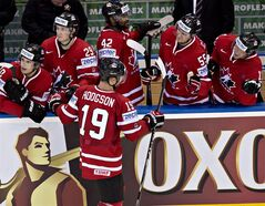Team Canada's Cody Hodgson, centre, is congratulated by teammates after scoring his third goal in a 6-1 win against Denmark during third period action on Thursday, May 15, 2014 at the IIHF World Hockey Championship in Minsk Belarus. From the left, Brayden Schenn, Nathan MacKinnon, Cody Hodgson, Joel Ward, Mark Scheifele, Jonathan Huberdeau. THE CANADIAN PRESS/Jacques Boissinot
