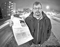 Eric Zipman holds a photo radar ticket that says he drove 72 km/h on Grant Avenue at Nathaniel Street -- which he denies.