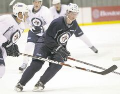 Defenceman Jacob Trouba will take his crushing shot to the Michigan Wolverines this fall.
