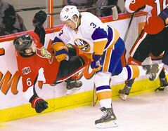New York Islanders defenceman Travis Hamonic crushes Ottawa Senator Bobby Ryan in an early-November game.