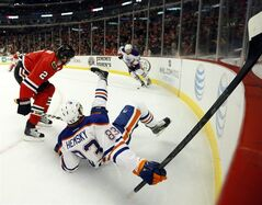 Chicago Blackhawks defenseman Duncan Keith (2) checks Edmonton Oilers right wing Ales Hemsky, from the Czech Republic, to the ice during the first period of an NHL hockey game Sunday, March 10, 2013 in Chicago. (AP Photo/Charles Rex Arbogast)