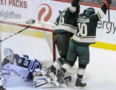 Winnipeg Jets goalie Chris Mason gives up a goal to Minnesota Wild's Devin Setoguchi (10) in the first period of their NHL game Thursday, in St. Paul, Minn.