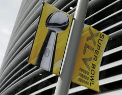 A banner is seen outside MetLife Stadium Monday Jan. 27, 2014, in East Rutherford, N.J. The stadium will host Sunday's NFL Super Bowl XLVIII football game between the Denver Broncos and the Seattle Seahawks. (AP Photo/Charlie Riedel)
