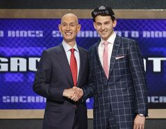 Nik Stauskas, right, poses for a photo with NBA Commissioner Adam Silver after being selected eighth overall by the Sacramento Kings during the 2014 NBA draft, Thursday, June 26, 2014, in New York. (AP Photo/Jason DeCrow)