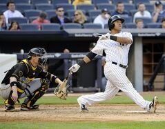 New York Yankees' Yangervis Solarte hits a home run as Pittsburgh Pirates catcher Chris Stewart, left, looks on during the sixth inning of the second game of a baseball double-header Sunday, May 18, 2014, at Yankee Stadium in New York. (AP Photo/Bill Kostroun)