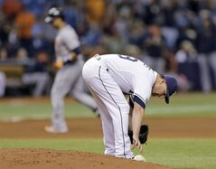 Tampa Bay Rays relief pitcher Kirby Yates reaches for the rosin bag as Detroit Tigers' Victor Martinez rounds the bases after hitting a grand slam during the seventh inning of a baseball game Wednesday, Aug. 20, 2014, in St. Petersburg, Fla. (AP Photo/Chris O'Meara)