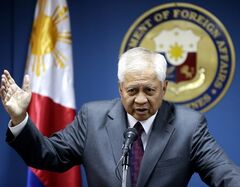 Philippine Foreign Affairs Secretary Albert Del Rosario gestures during a news conference Wednesday June 19, 2013 in Manila, Philippines where he talked about three big issues involving the Philippines that included the presence of the Philippine contingent to the UN peacekeeping forces at the Golan Heights. Del Rosario said the Philippines still is committed to keep the Philippine peacekeepers until August 3, 2013 and subject to