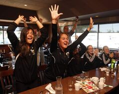 Members of  the University of Manitoba Bisons' women's soccer team jump for joy this morning as they watch the Canadian Olympic team beat France 1-0 to win a bronze medal. The Bisons gathered to cheer on former Bison and Bison coach Desiree Scott, and her Canadian teammates.