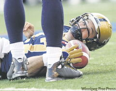 Bombers quarterback Stefan LeFors involuntarily lies down on the job after another play goes wrong in the battle against the Argos at Canad Inns Stadium on Friday.