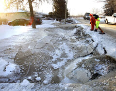 City crews work along the ditch on Laxdal Road near Ridgewood Avenue after a major water main break Sunday.