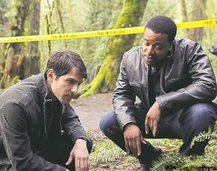 David  Giuntoli  (left), and  Russell  Hornsby  might be  on to the big,  bad wolf  in Grimm.