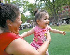 Ella Hudson plays with her 13-month-old granddaughter, Summer-Lynn Hudson, at Central Park Saturday during Community Vibe Day.