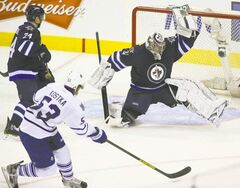 Ondrej Pavelec was brilliant, including this flash of leather to stone Michael Kostka.