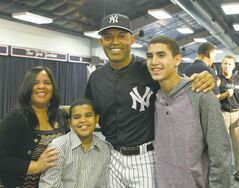 New York Yankees pitcher Mariano Rivera, who holds baseball�s all-time saves record, poses for a photograph with his wife Clara, sons Jaziel, left, and Jafet, right, after announcing his plans to retire at the end of the 2013 season during a news conference at Steinbrenner Field Saturday, March 9, 2013 in Tampa, Fla. (AP Photo/Kathy Willens)