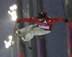 Canada's Mike Riddle gets air during men's ski half pipe qualifying at the Rosa Khutor Extreme Park, at the 2014 Winter Olympics, Tuesday, Feb. 18, 2014, in Krasnaya Polyana, Russia. (AP Photo/Sergei Grits)