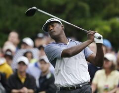 In this Aug. 9, 2013, photo, Vijay Singh, of Fiji, watches his tee shot on the 10th hole during the second round of the PGA Championship golf tournament at Oak Hill Country Club in Pittsford, N.Y. Singh received a favorable ruling in his lawsuit against the PGA Tour when a judge allowed his complaint that he was treated differently from other players under the tour's anti-doping policy. The New York State Supreme Court only partially dismissed the lawsuit, meaning the case could be headed for trial. (AP Photo/Charlie Neibergall)