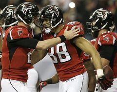 Atlanta Falcons tight end Tony Gonzalez (88) celebrates his touchdown with Atlanta Falcons Matt Ryan against the Washington Redskins during the first half of an NFL football game, Sunday, Dec. 15, 2013, in Atlanta. (AP Photo/John Bazemore)