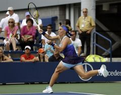 Svetlana Kuznetsova, of Russia, returns a shot against Marina Erakovic, of New Zealand, during the first round of the 2014 U.S. Open tennis tournament, Tuesday, Aug. 26, 2014, in New York. (AP Photo/Frank Franklin II)