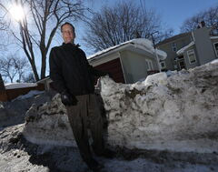 John Orlikow with windrows in an Alley between Fleet and Waterloo in River Heights, Friday, March 14.